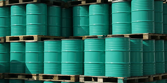 Photo of stacked oil barrels