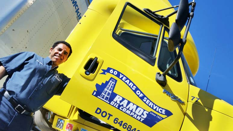 Photo of a Ramos Oil driver standing next to his Ramos Oil Fuel Delivery Truck